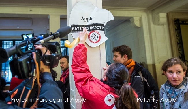 2 attac protest against apple
