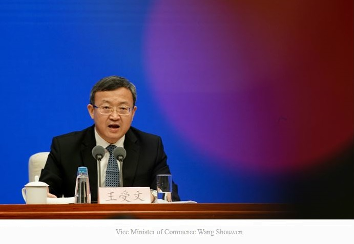 1 X cover Vice Minister of Commerce China  Wang Shouwen