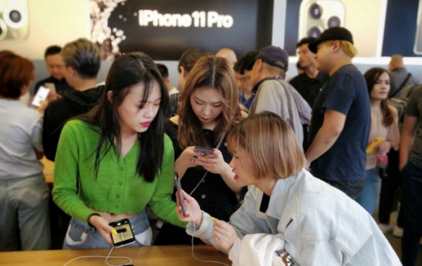 Apple's iPhone 11 Pro sold out in a Flash at their Upscale Store in Beijing with Scalpers saying Fans didn't want the Entry iPhone