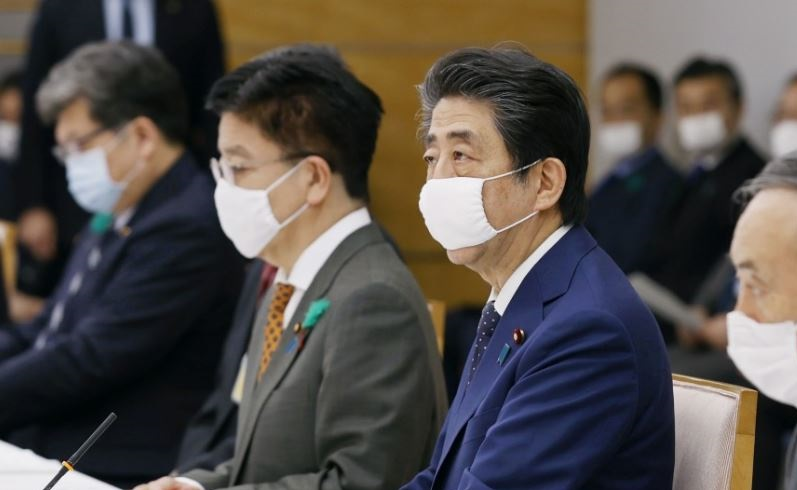 1 Cover Japan's PM extends shut down due to wuhan virus