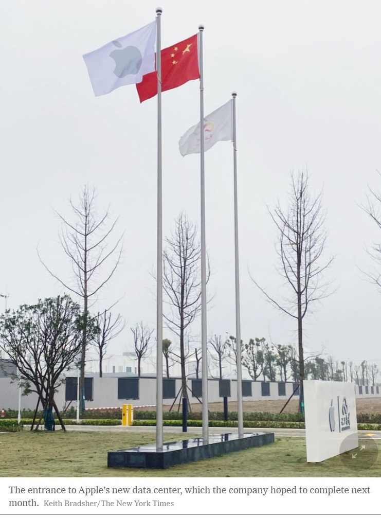 2 Apple and Chinese Flags fly at new data center