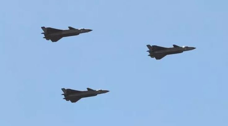 2 Chinese fighters fly overhead